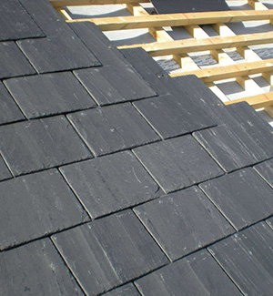 Part way through a slate roof in Coventry
